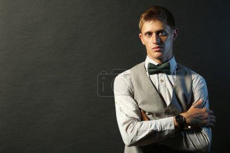 Portrait of elegant man on dark background