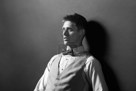 Black and white photo of elegant man