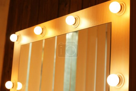 Makeup place with mirror and light bulbs