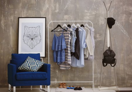 Fashionable clothes at modern dressing room
