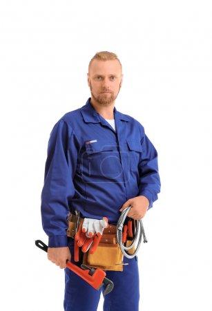 Photo pour Beau plombier avec clé à tube et tuyau flexible isolé sur blanc - image libre de droit