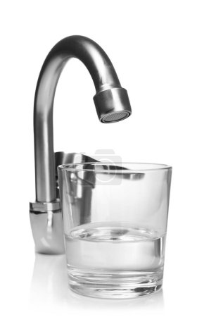 Glass of water and tap