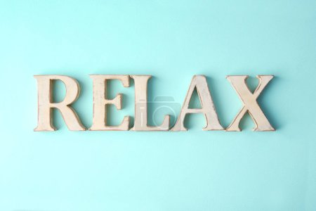 Photo for Wooden word RELAX on color background - Royalty Free Image