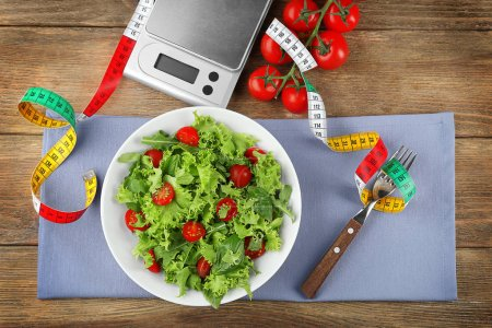 Fresh healthy salad and  scales