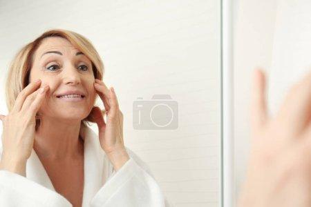 Senior woman doing facial massage
