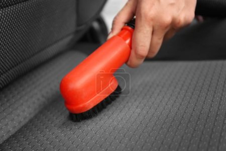 male hand cleaning car