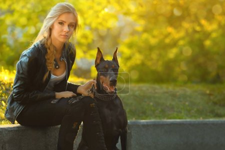 Woman and her dog in green park