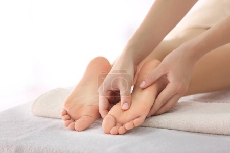 Photo for Foot massage in spa salon, closeup - Royalty Free Image