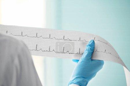 Cardiologist holding cardiogram