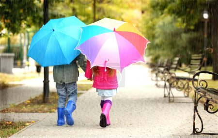 Cute children with umbrellas