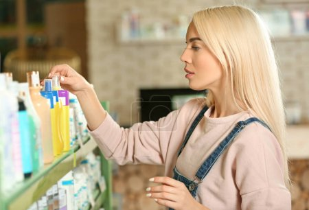 woman selecting animal shampoo