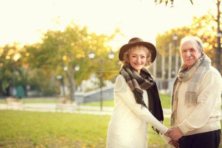 Mature couple in autumn park