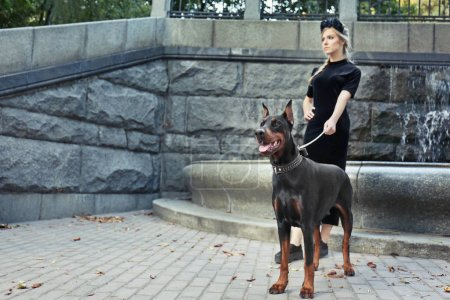 woman and her dog near fountain