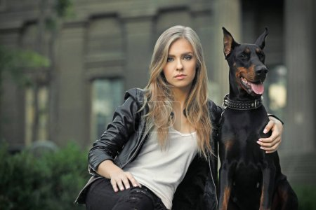 Woman with her dog outdoors