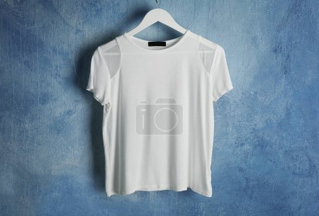 Photo for White t-shirt against grunge wall background - Royalty Free Image