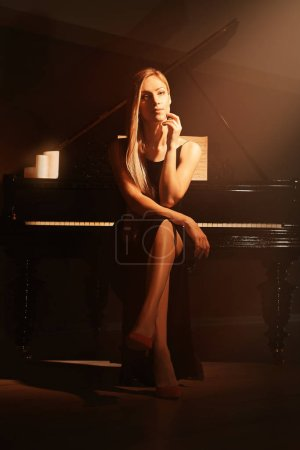 Beautiful woman at piano