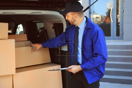 Delivery man checking list