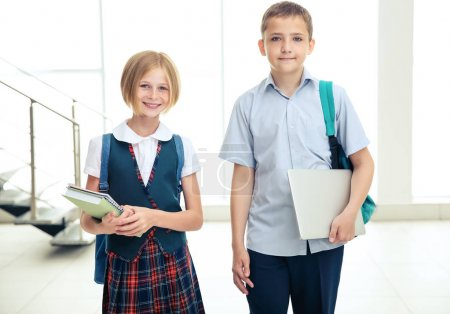 Cute schoolkids with notepads