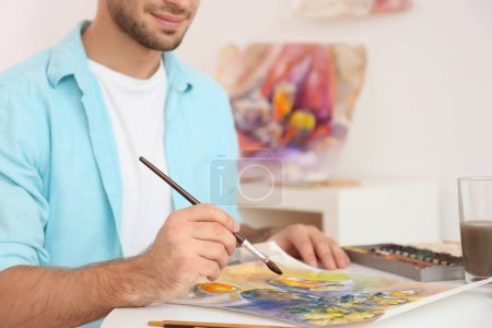 Male artist painting picture