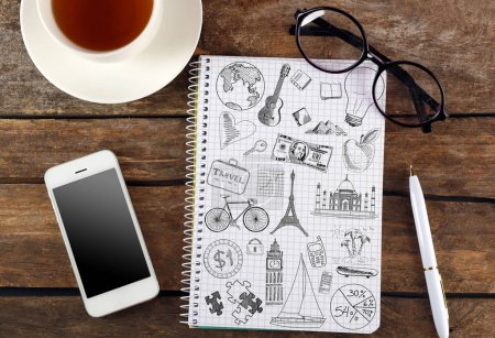 Notebook with drawings and cup of coffee