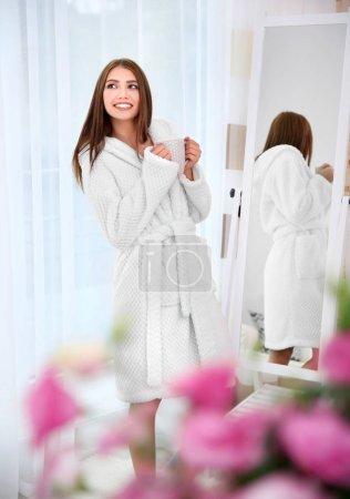girl in bathrobe relaxing