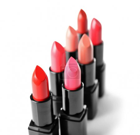 Assortment of lipsticks on white background