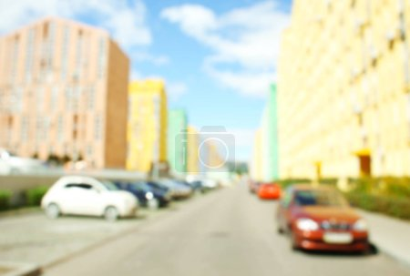 cars near modern colorful buildings