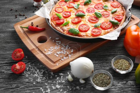 Delicious pizza on kitchen table