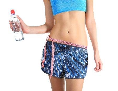 Woman holding plastic bottle