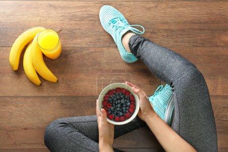 girl with healthy food on floor