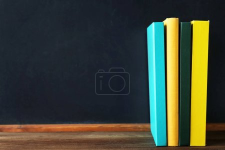 stacked Books and blackboard