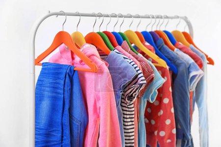 Clothes hanging on rack, closeup
