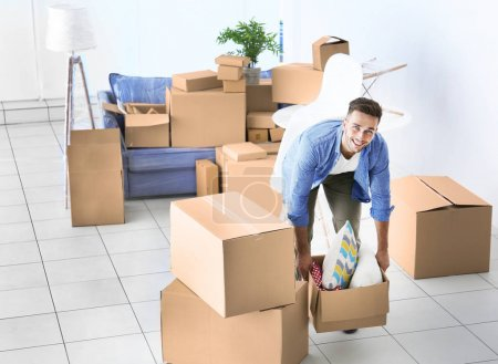 Photo for House moving concept. Man holding cardboard box, closeup - Royalty Free Image