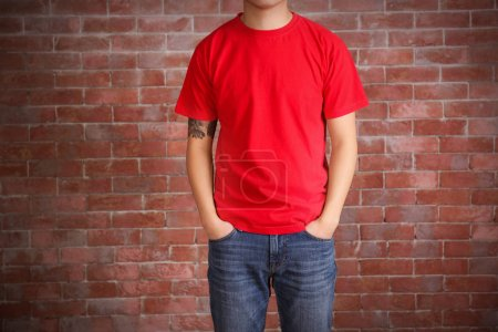 Young man in blank red t-shirt