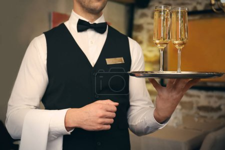 Photo for Waiter serving champagne at restaurant, close up view - Royalty Free Image