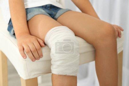 girl's knee with bandage