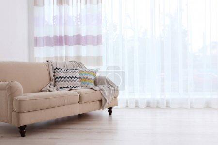 sofa on curtain background