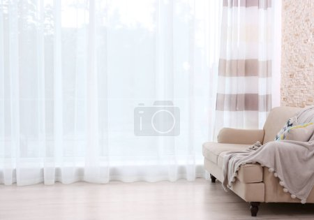 New sofa on curtain background