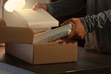 Courier putting parcel