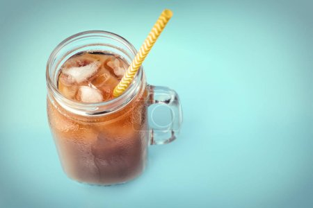 Photo for Jar of iced coffee with milk and straw on blue background - Royalty Free Image