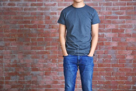 Young man in blank grey t-shirt