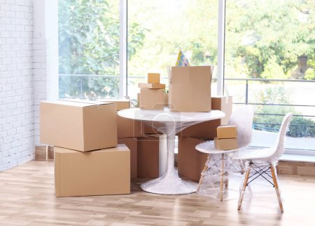 Photo for House moving concept. Boxes and furniture in the room - Royalty Free Image