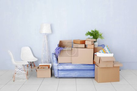 Photo for House moving concept. Boxes with furniture in empty room - Royalty Free Image