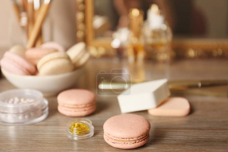 Tasty macaroons and beauty accessories