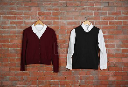 School uniform on brick wall