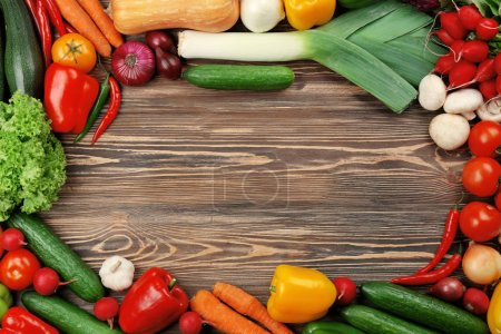 Photo for Ripe Fresh vegetables on wooden background - Royalty Free Image