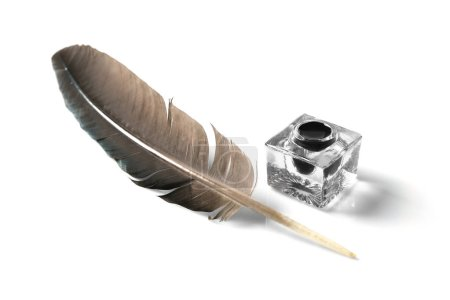 Feather pen and inkwell