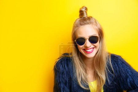 Photo for Young beautiful woman on yellow background - Royalty Free Image