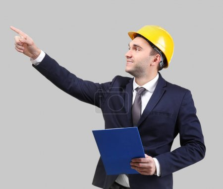 man with clipboard and hardhat