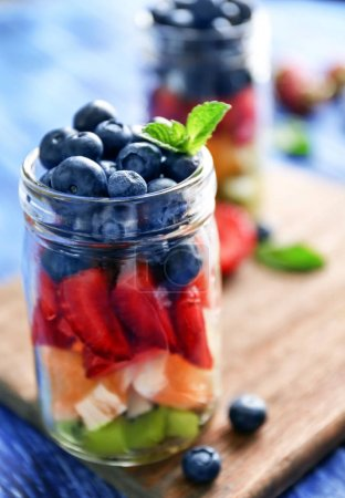 Glass jars with fruits and berries